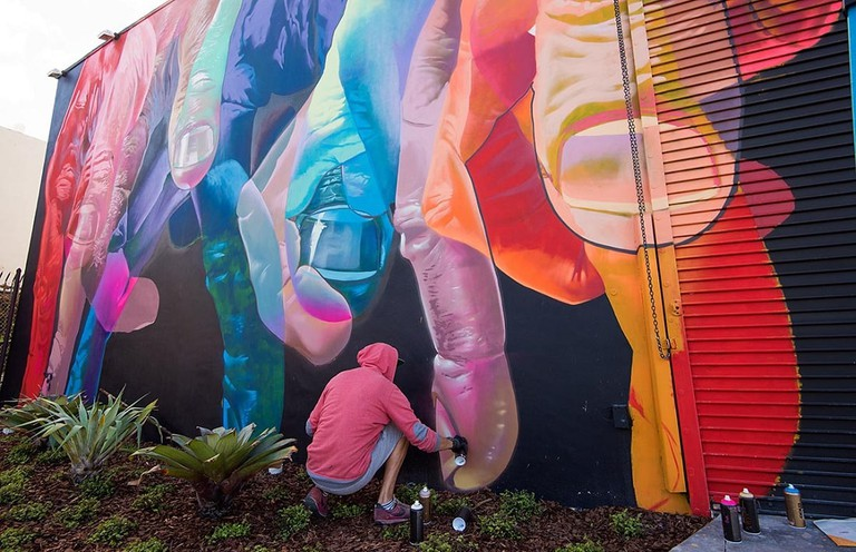 Artist at work on a mural for 2016