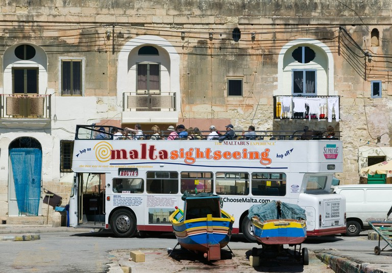 Sightseeing tour bus in Marsaxlokk, Malta