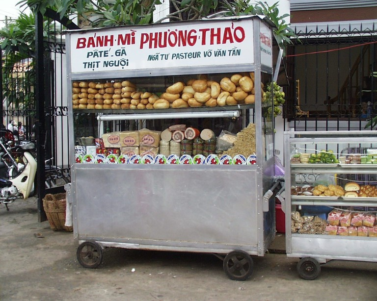 Bánh mì food cart with distinctive Saigon lettering