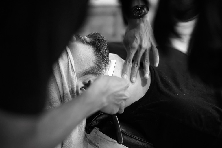 Shaving with a cut throat blade