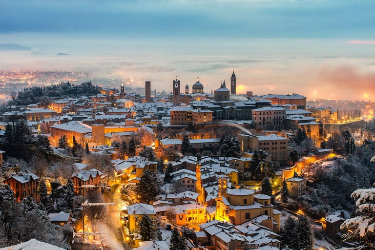 Snow-covered Bergamo at sunrise