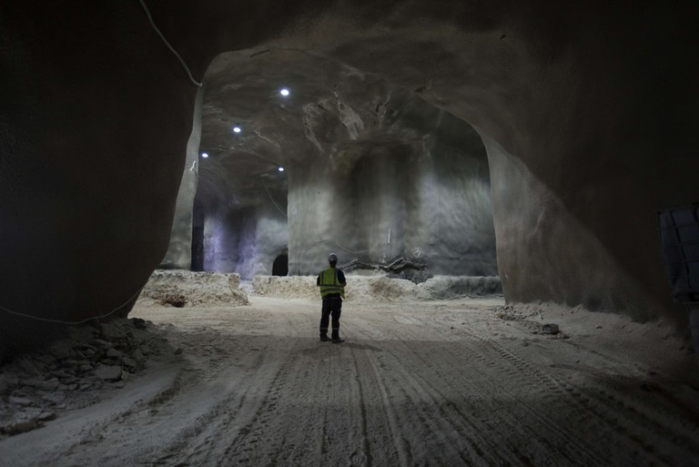 Workers inside the massive partially constructed underground burial tunnels