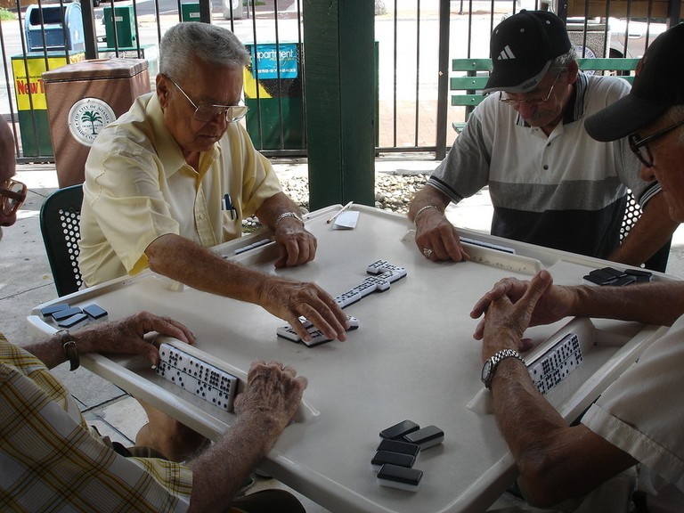 Gentlemen playing dominos at Maximo Gomez Park