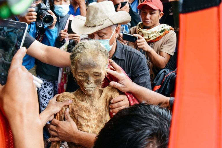 A Toraja woman, who has been dead for 30 years, is given a new dress during the Ma'nene Festival