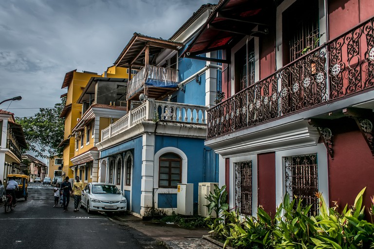 Houses painted in yellow, blue, and red in Fontainhas
