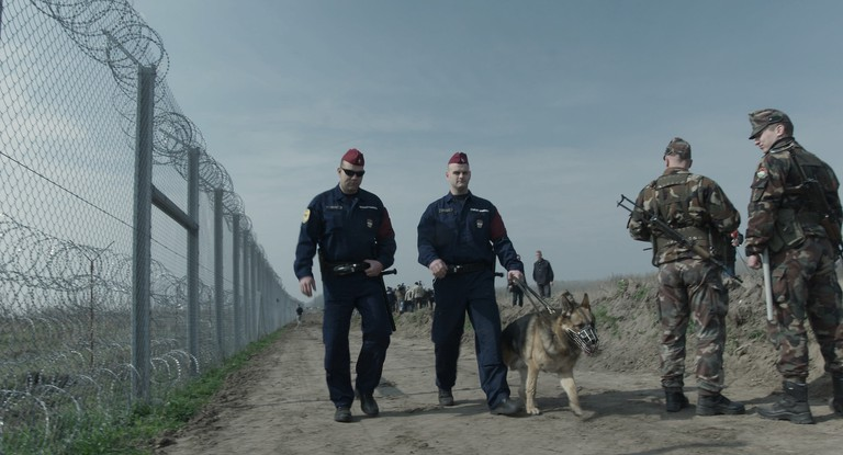 Human-Flow_Still_2016_03_28_Borderguards_Hungary copy