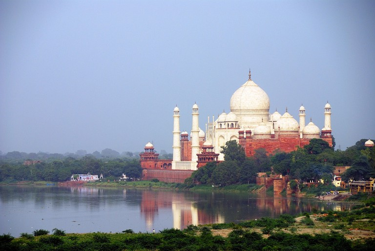 The iconic Taj Mahal as seen from the banks of the Yamuna River in Agra, India