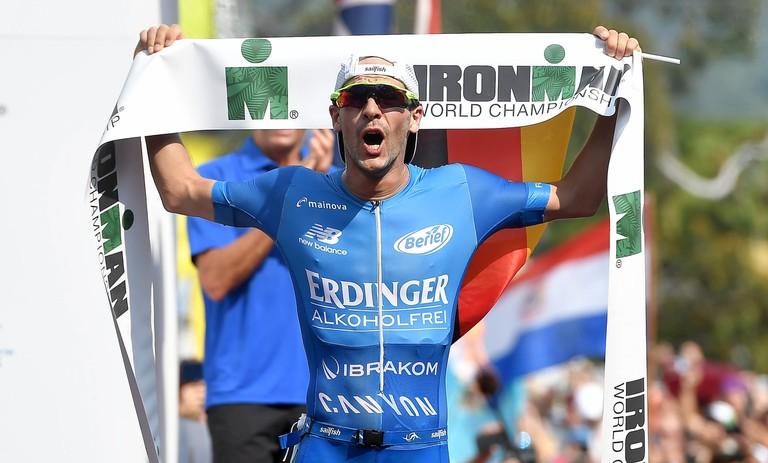 Patrick Lange celebrates winning the 2017 IRONMAN World Championship