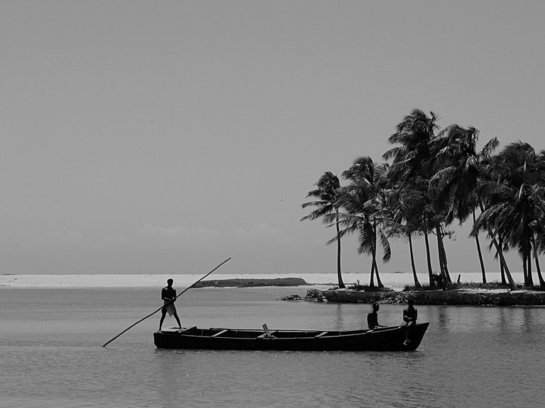 Fishermen in the backwaters