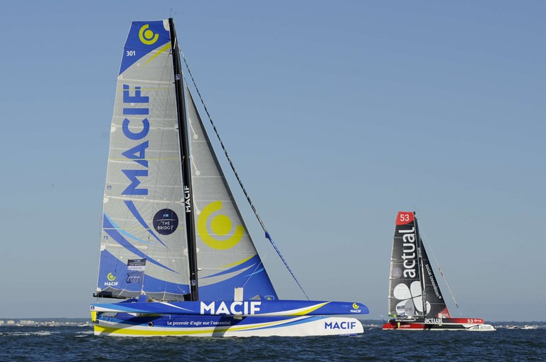 French skipper François Gabart sails is Ultim trimaran Macif and french skipper Yves Le Blevec Sails his Ultim trimaran Actual during the start of the race