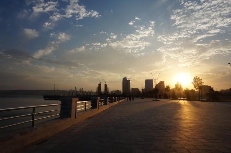 The beautiful sunset from the promenade over Baku