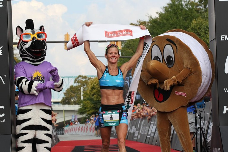 Liz Lyles holding the banner at IRONMAN Chattanooga