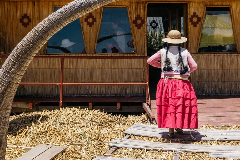 The Uros women take tourists around the island