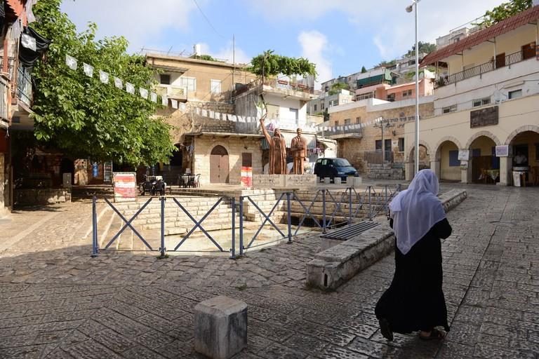 A woman walking in the Druze town of Peki'in, Israel