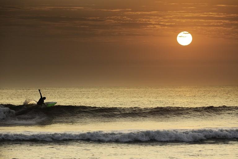 Surfer making a perfect turn in Peru