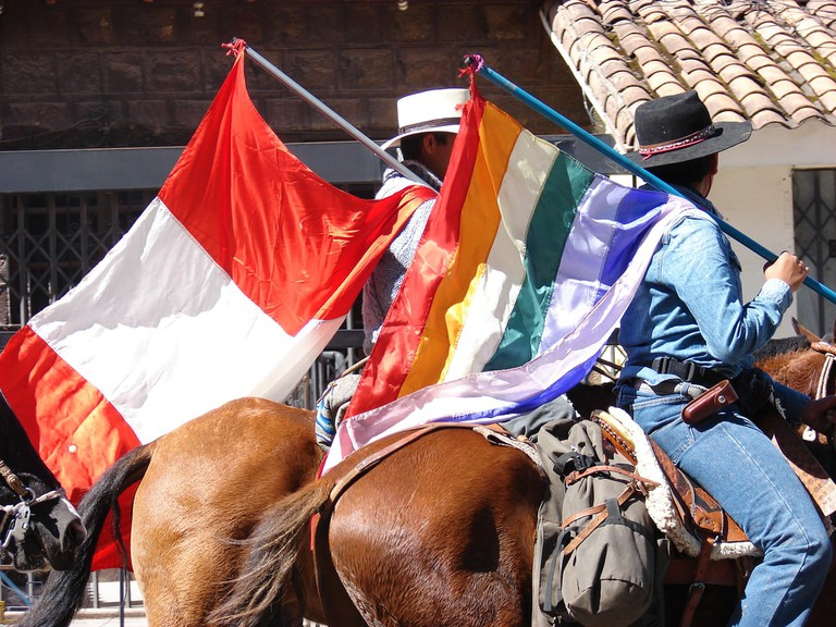 Cusco and Peruvian flag side by side