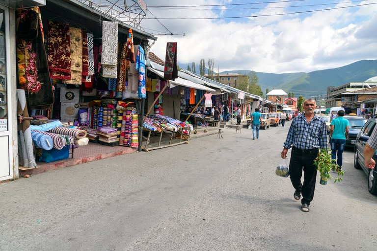 A local market selling carpets and clothes in Sheki