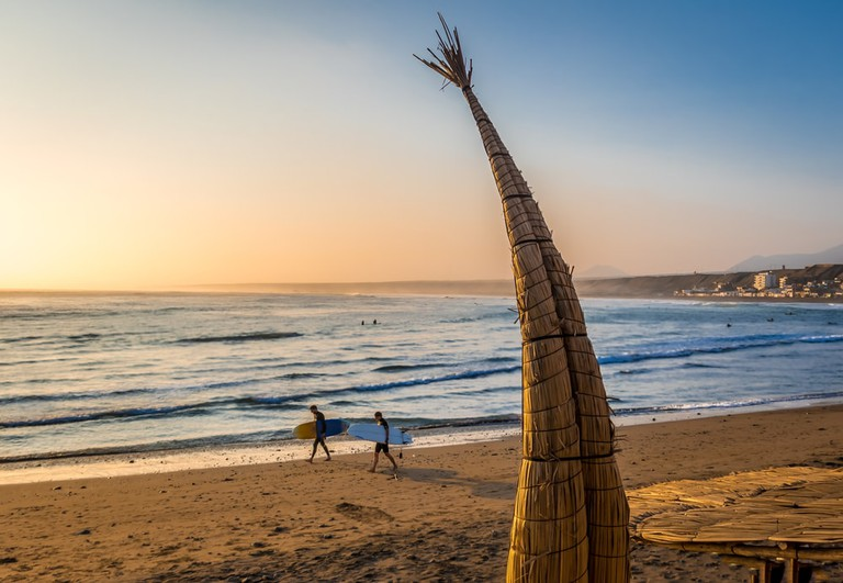Huanchaco Beach and the traditional reed boats, Peru