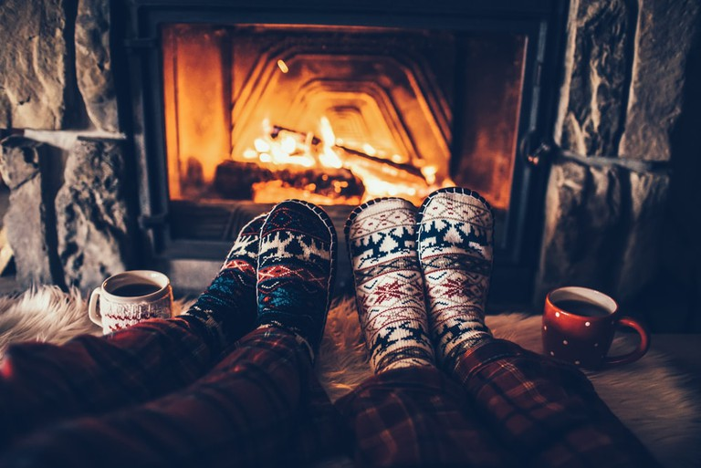 A fireplace and cosy slippers are definitely gemütlich