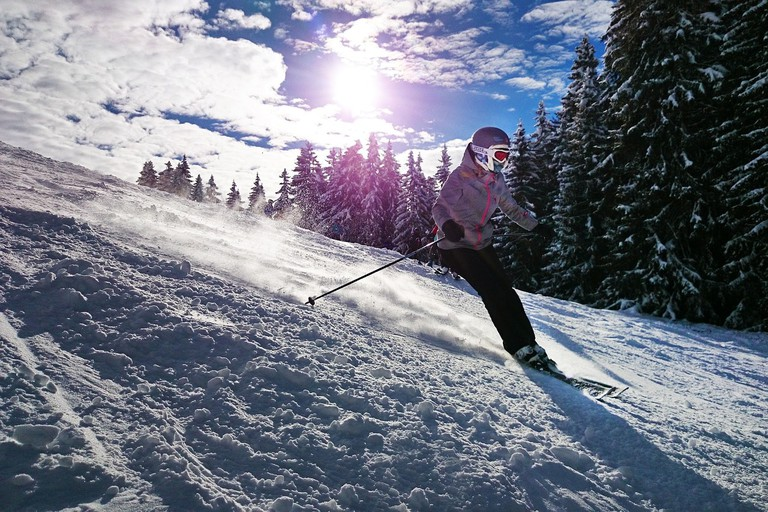 A girl skiing in the sun