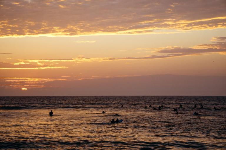 Surfers sunset in Mancora, Peru