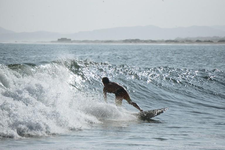 Surfing in Mancora, Peru