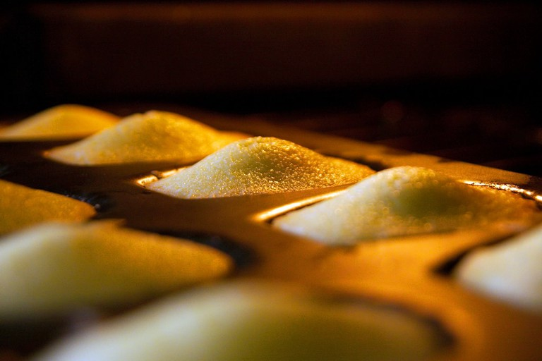 Madeleines during the baking process