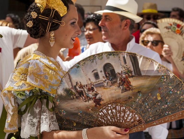a Valencian Fallera in traditional dress