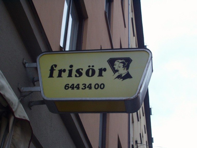 Frisor means hairdresser in Sweden so look out for a sign like this