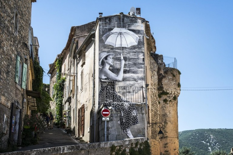 Agnès Varda and JR's image of the lady with the parasol, photographed in the South of France, in Faces Places