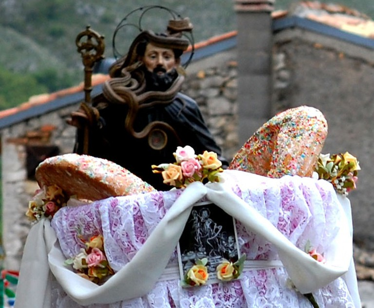 Statue of St Dominic covered in snakes