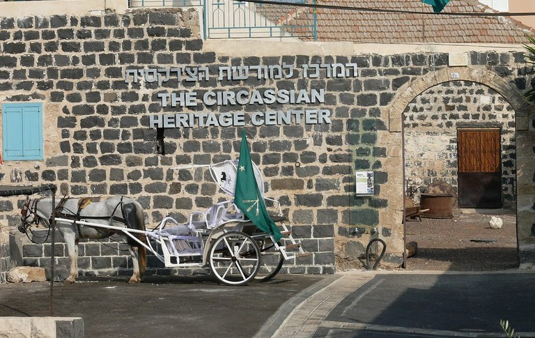 A horse and cart stands outside the Circassian Heritage Centre, northern Israel