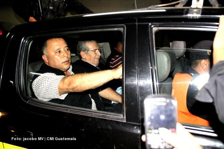 Rios Montt can be seen in the middle seat of the pickup in Guatemala