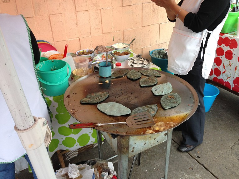 Tlacoyos on the comal│
