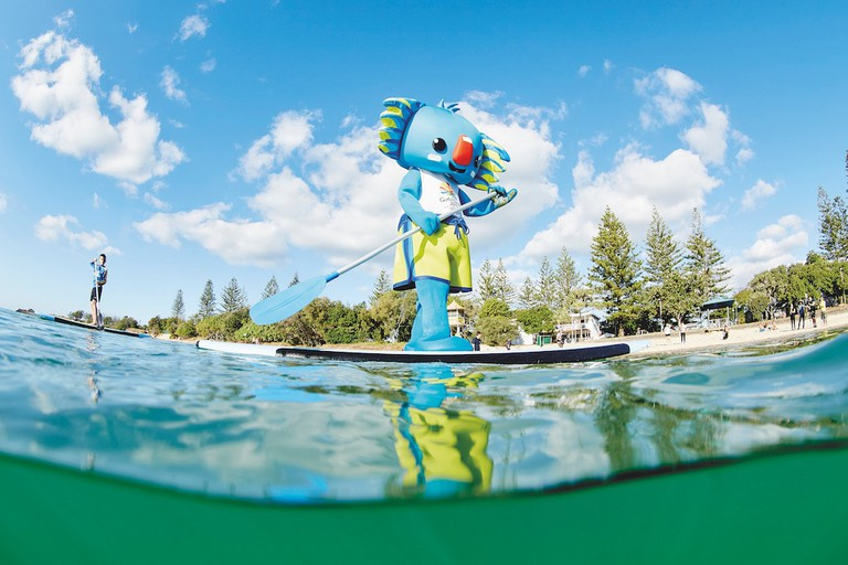 Borobi the mascot paddleboards along Tallebudgera Creek