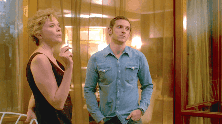 Gloria (Annette Bening) and Peter (Jamie Bell) gaze at the Chrysler Building in Film Stars Don't Die in Liverpool