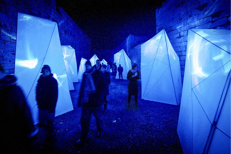 Visitors in the iceberg installation of Lumina Borealis at Fort Henry
