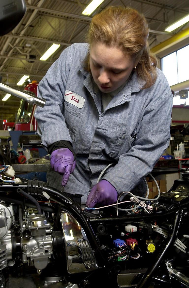 Mechanic Fixing It Up