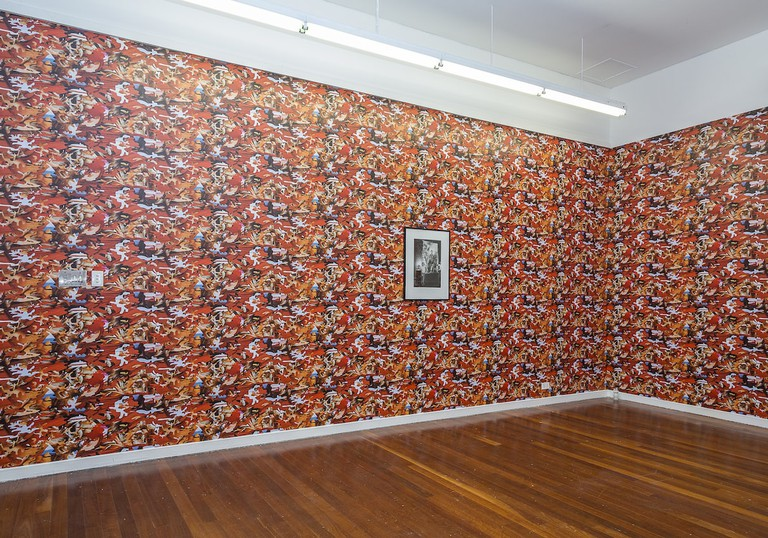 Installation view of colourful wallpaper designed by artist Pio Abad