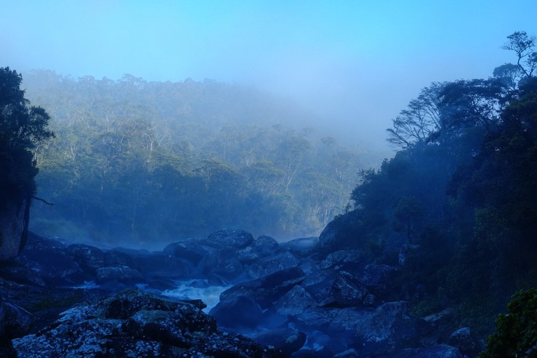 An ethereal blue dawn above one of Ranomafana's many waterfalls