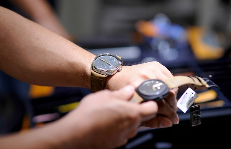 selecting a wrist watch from shop