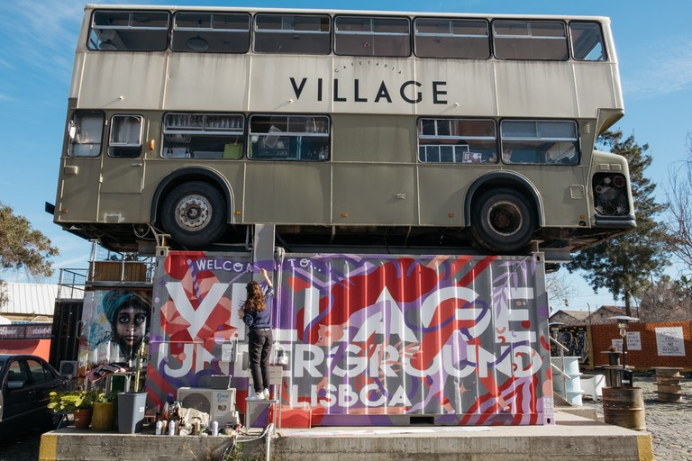 Kruella painting a container at Village Underground