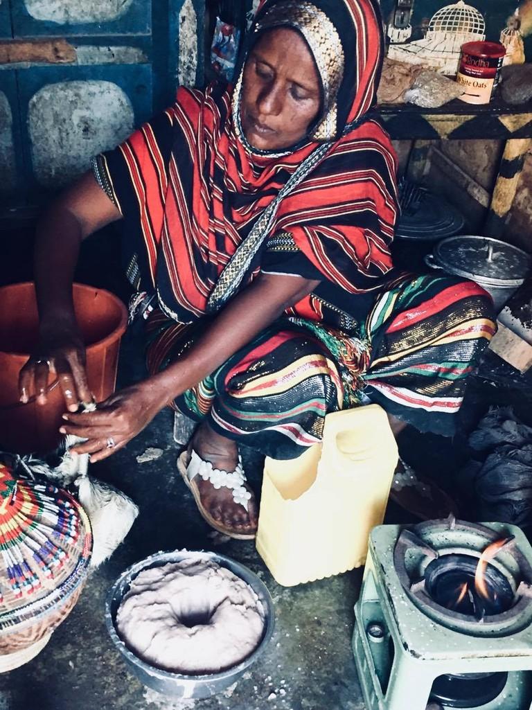 An Afar woman baking traditional bread