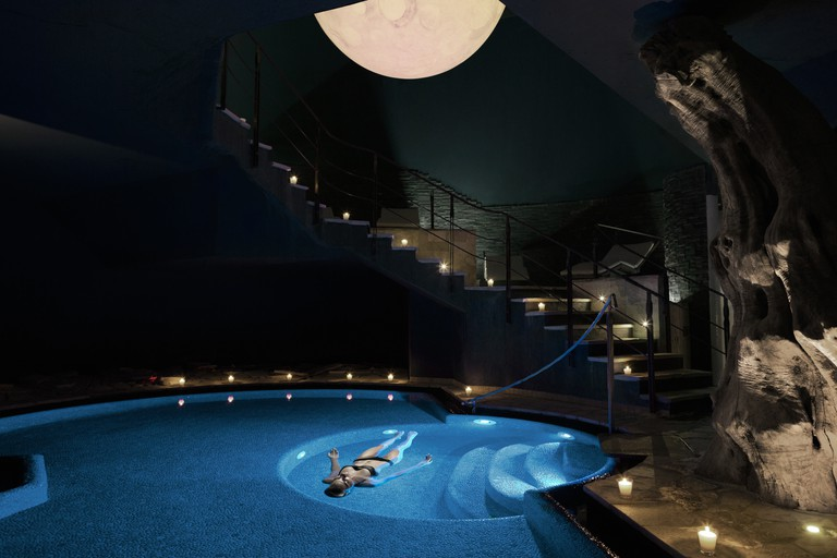 A guest floats in a saltwater pool at Lefay Resort and Spa in Italy