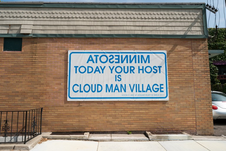 26313016739_16a1886308_kMinnesota Today Your Host Is Cloud Man Village by Edgar Heap of Birds at Bockley Gallery, MN | © Lorie Shaull/Flickr