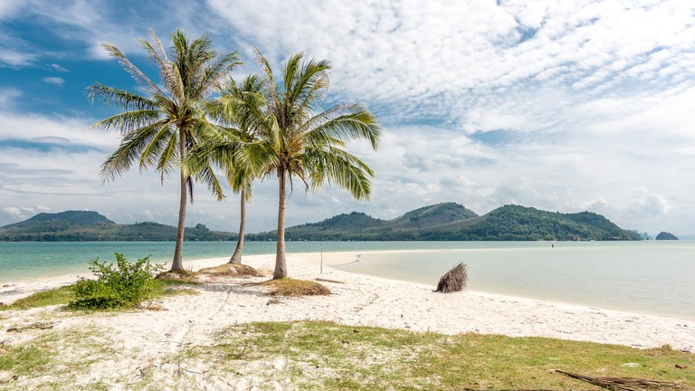 Sand, palms, hills, and sky at Koh Yao Yai, Thailand