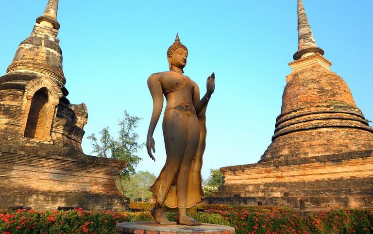 Serene walking Buddha statue