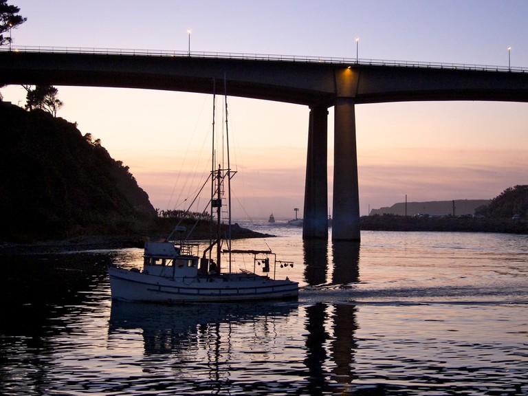 Boat returning to Noyo Harbor near dusk