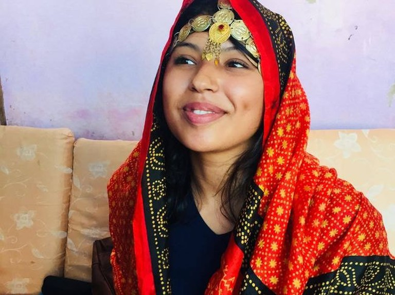Wearing the traditional scarf of the Afar tribe: a scarf usually worn by the bride