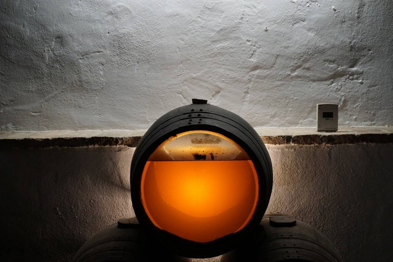 A see-through barrel at Lagar Blanco, clearly showing the layer of sediment which gives the wine its character